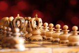 Photo chess board focus to white king with red abstract background