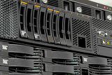 Fotografie servers stack with hard drives in a datacenter for backup and data storage