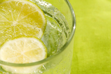 glass of sparkling water and lemon refreshment for background
