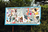 big advertising billboard with old torn posters