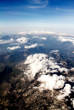 Fotografie view of the mountains from an airplane above the clouds