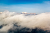 Photo view of the mountains from an airplane above the clouds