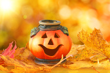 halloween pumpkin lantern with chestnuts cones and autumn leaves