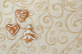 homemade gingerbreads on christmas ornament background
