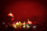 dark red christmas background with red ball and glow stars