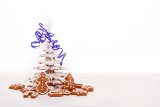 homemade christmas gingerbreads tree with blue ribbon on white background