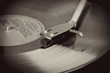 Photo spinning vinyl record motion blur image vintage toned