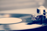 Fotografie spinning vinyl record motion blur image  vintage toned shallow depth of field