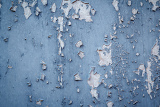 peeling paint from blue grunge background