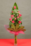bouquet of eleven red roses in vase