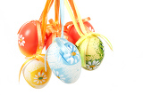 Fényképek hanged bright color easter eggs with bows isolated on white background