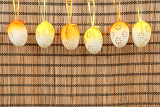 Fotografie bright color easter eggs with bows on wooden background