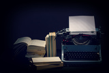 Photo old typewriter with opened books retro colors with black background