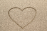 heart shape drawn in sand for natural symboltourismholi day or conceptual designs