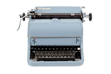 Fotografie retro blue typewriter on white background