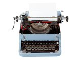 Fotografie retro uncovered blue typewriter on white background