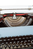 retro typewriter close up with detail of keys and letters mechanism