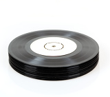 stack of black vinyl records on white background