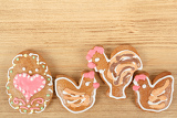 easter gingerbreads rooster and hen on wooden background