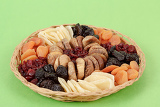 various dried exotic fruits on green background