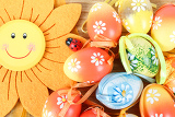 bright color easter eggs with bows on wooden desk