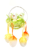 Fotografie easter decoration with colored eggs and birds on white background