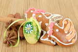 easter gingerbreads and painted egg on wooden background