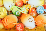 Fotografie close up of painted easter eggs with ribbon
