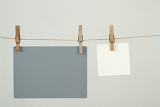 Fotografie white and grey memory note papers hanging on cord