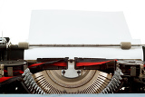 retro typewriter close up with paper and letters mechanism