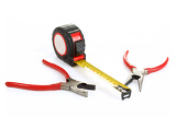 two different red pliers and measuring tape isolated on white