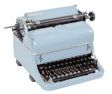 Fotografie view retro blue typewriter on white background
