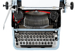 Fotografia retro uncovered blue typewriter on white background