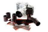 analog vintage slr camera and color negative films on white background