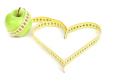 Fotografie green apple with a measuring tape and heart symbol isolated on white background