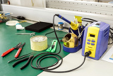Photo electronics equipment assembly workplace with solder and necessary tools