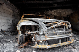 close up photo of a burned out car in garage after fire for grunge use