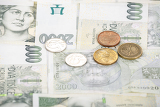 czech banknotes nominal value two thousand crowns and coins as background