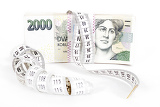 Photo banknotes of czech crowns money concept of expensive bill with measurement tape