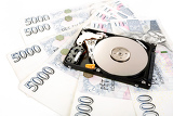 the open hard disk with czech money banknotes money concept backup data cost