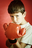 young boy boxer with red boxing gloves