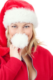 Fotografie portrait of joyful pretty woman in red santa claus hat smiling on white background