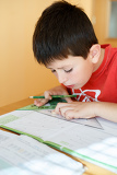 Fényképek boy doing school homework from mathematics geometry in workbook