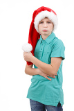 teenager wit red santa hat and bored expression on his face