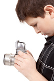 young boy with old vintage analog slr camera looking to viewfinder