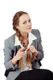 middle age business woman with hands doing a braid a long mane on a isolated background