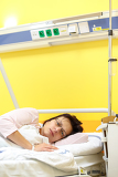 Fotografie real people in real situation sad middleaged woman lying in hospital with pneumonia