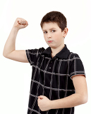 Fotografie portrait of a young boy with hand raised up and showing its own muscles against white background