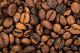 texture from roasted coffee beans for background or backdrop