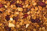 healthy homemade granola or muesli with oats dried raisin almonds hazelnuts and honey